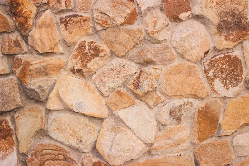 Decorative stonework, muted brown. Good background for photo wallpapers. royalty free stock images