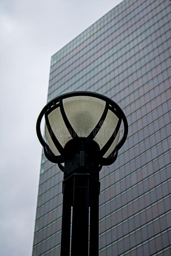 Lamp Post In Front Of A Downtown Toronto Office Building. A decorative street lamp stands in front of a downtown Toronto, Ontario, Canada office building royalty free stock image