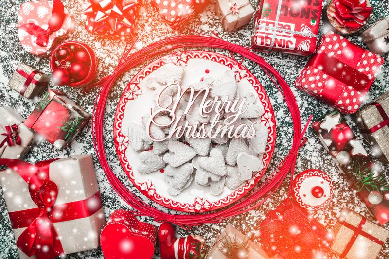 Decorative wands, with decorative Xmas plate and biscuits, cookies inside, on gray, stone, marble background. Above view, greeting card stock photography