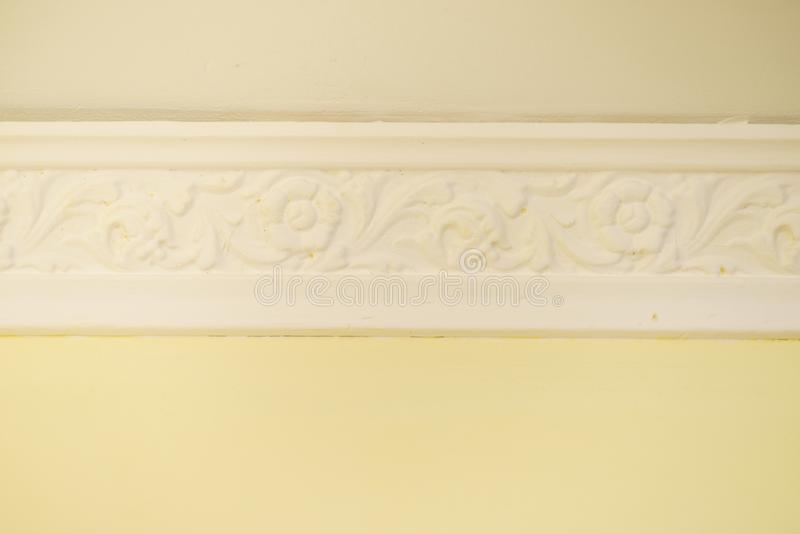 White cornce on wall. Decorative white cornice on yellow wall, home room decor, design and architecture concept royalty free stock photos