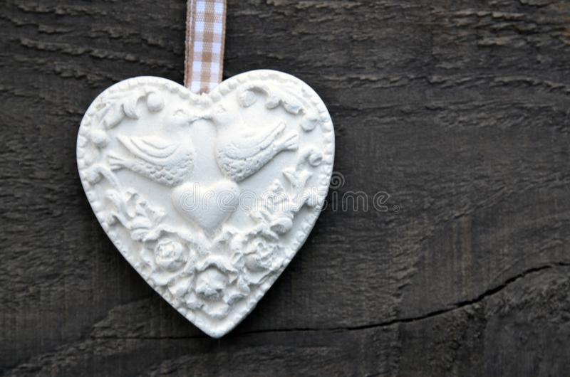 Decorative white heart on rustic wooden background.Valentine heart.Valentine`s Day or Love concept. stock photography