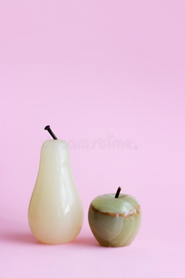 Decorative white stone pear and apple with copy space stock photography