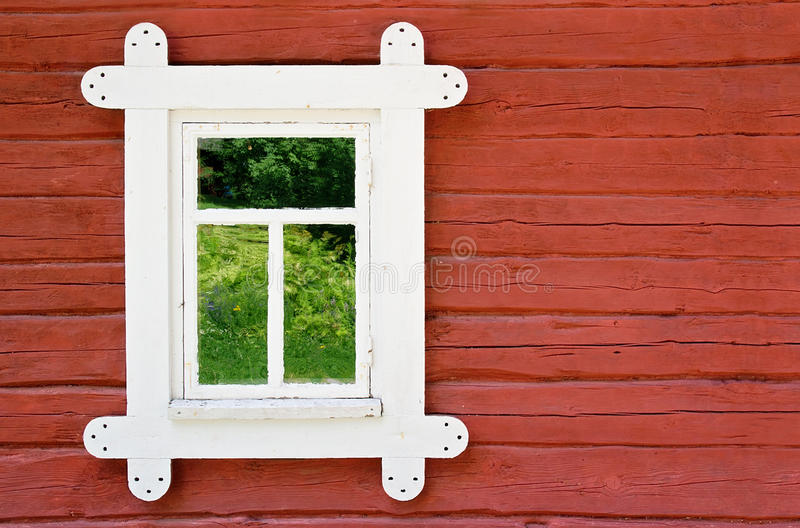 Decorative white window on an old farmhouse wall royalty free stock photos
