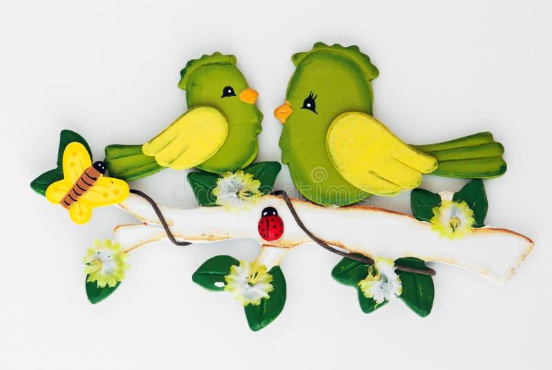 Decorative wooden birds. On white background royalty free stock photo