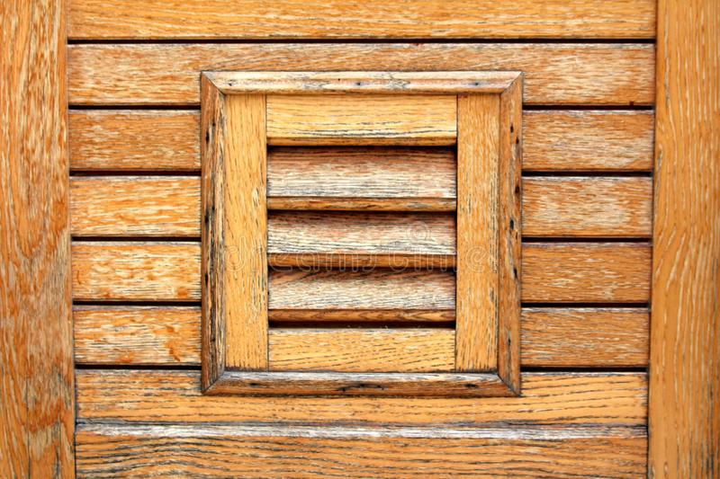 Decorative wooden boards texture made to look like window blinds on new wooden house wall royalty free stock photos