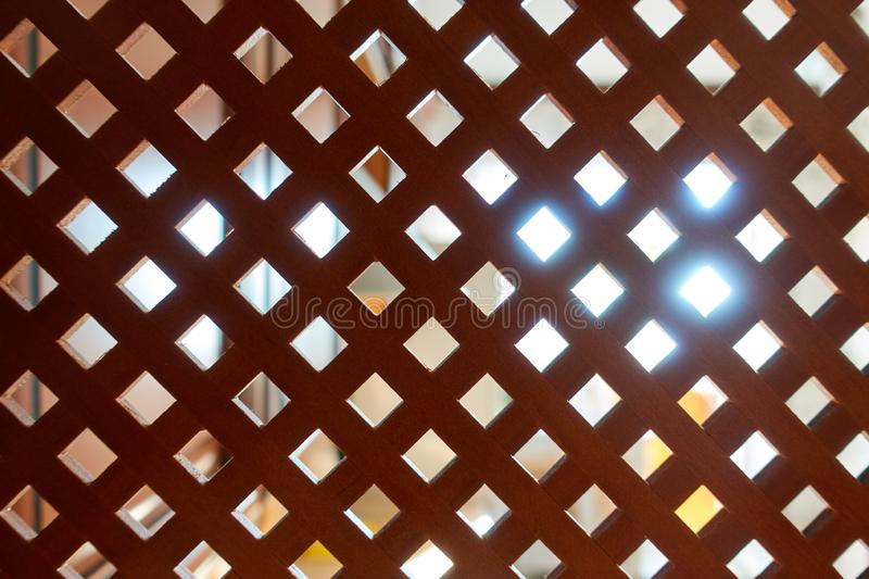 Decorative wooden lattice. Wooden background with light source at the back.  royalty free stock images
