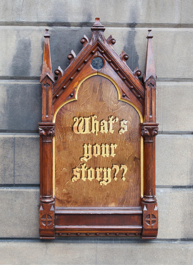 Decorative wooden sign - What's your story. Decorative wooden sign hanging on a concrete wall - What's your story stock photography