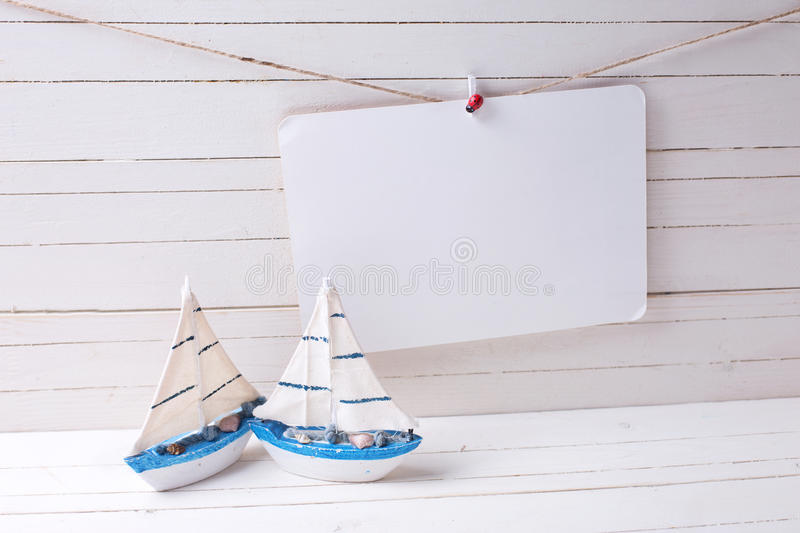 Decorative wooden toys sailing boats and empty tag on clothe royalty free stock image