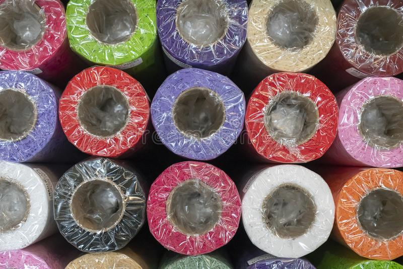 Decorative wrapping paper roll. Packed in plastic. royalty free stock photos