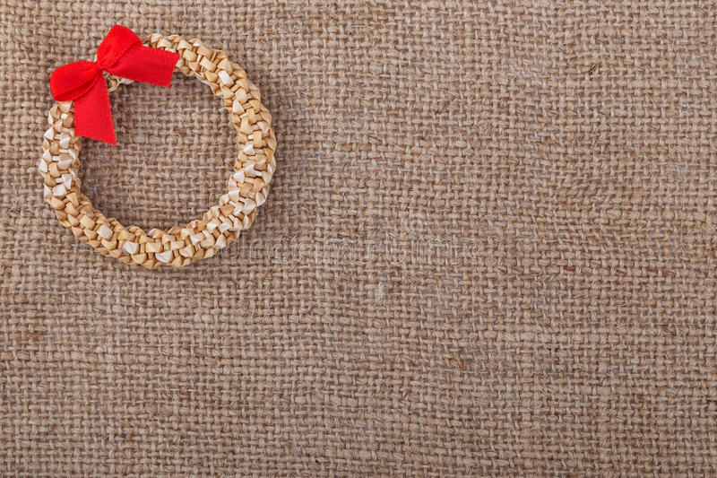 Decorative wreath straw sacking symbol of Christmas. Decorative wreath straw sacking symbol of New Year and Christmas royalty free stock photography