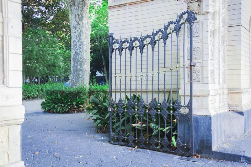 Decorative wrought iron gate or entranceway in Parco Bellini, Catania, Sicily, Italy stock photography