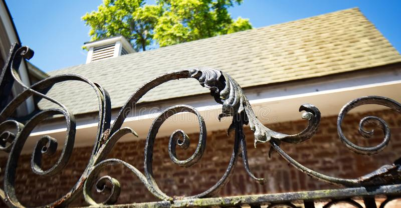 Decorative wrought iron on top of a gate. royalty free stock photos