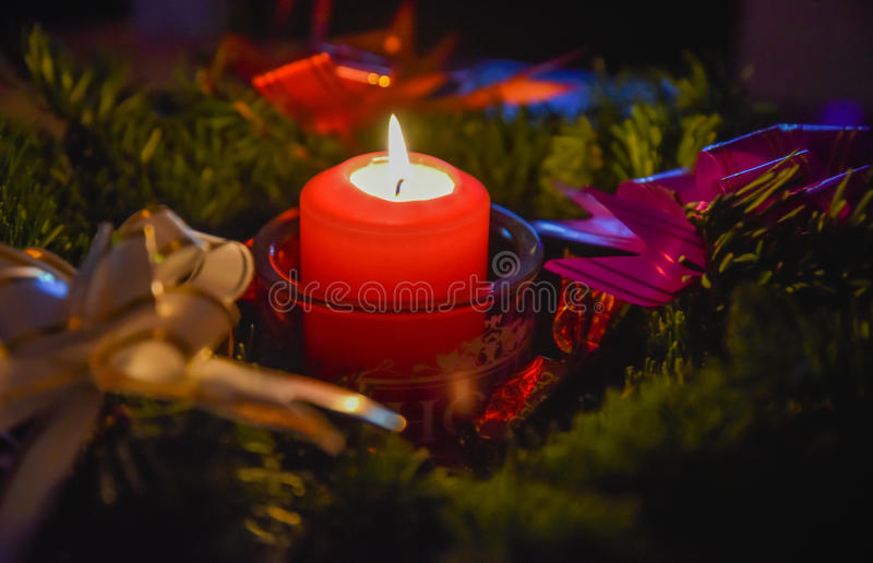 Decorative xmas candlelight. Beautiful indoor decoration for christmas decorative candle light in a fir wreath branch stock photography