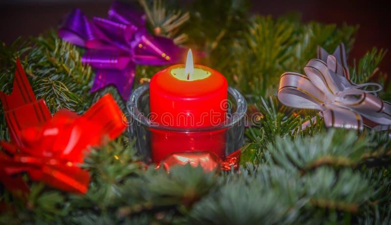 Decorative xmas candlelight. Beautiful indoor decoration for christmas decorative candle light in a fir wreath branch stock images