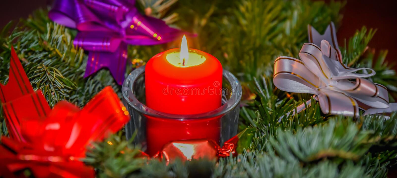 Decorative xmas candlelight. Beautiful indoor decoration for christmas decorative candle light in a fir wreath branch stock photo