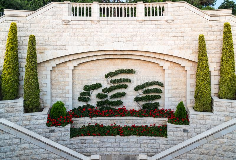 Decoratively decorated wall near the gate of the upper entrance to the Bahai Garden on the street Yefe Nof in Haifa. Haifa, Israel, June 30, 2018 : Decoratively stock images