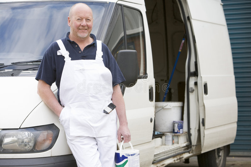 Decorator With Van. Decorator Standing Next To White Van royalty free stock photography