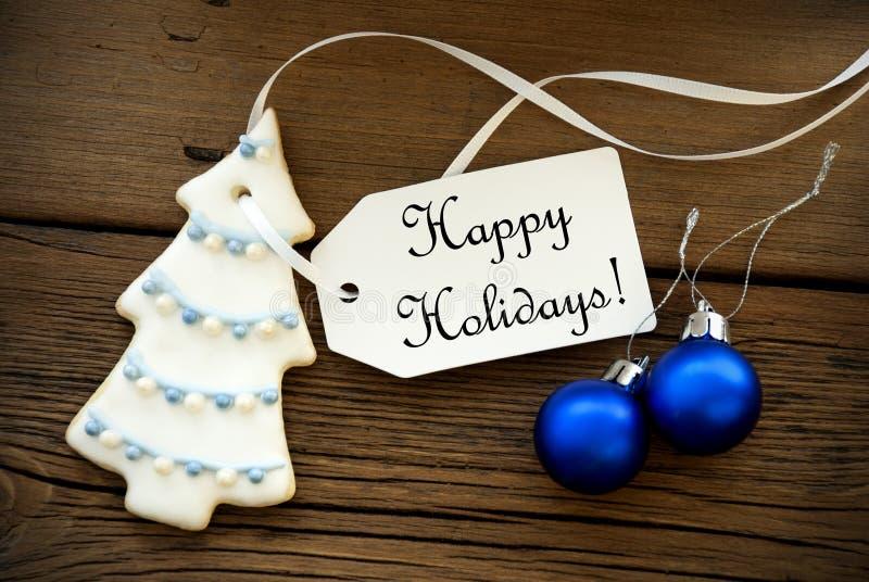 Decorazione di Natale con un'etichetta con le feste felici fotografia stock libera da diritti