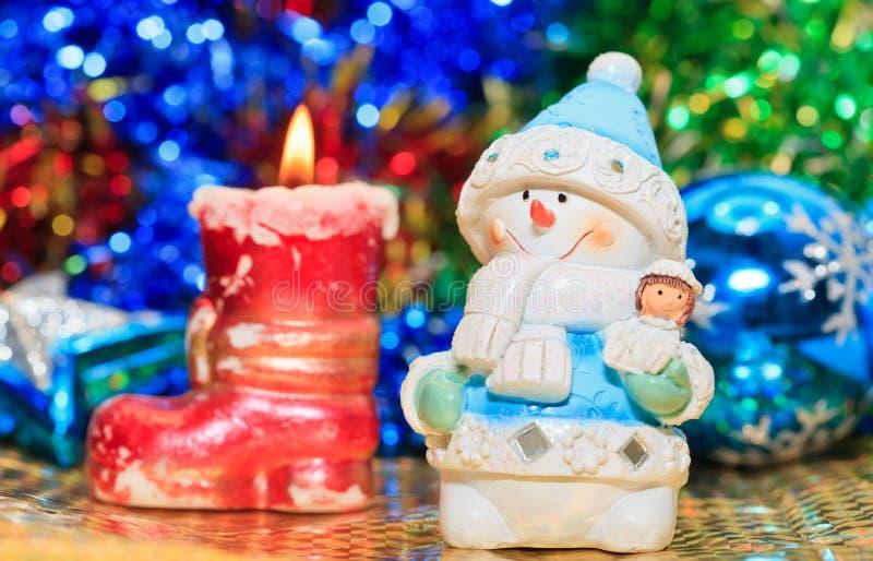 Decorazione di natale della candela del pupazzo di neve fotografia stock