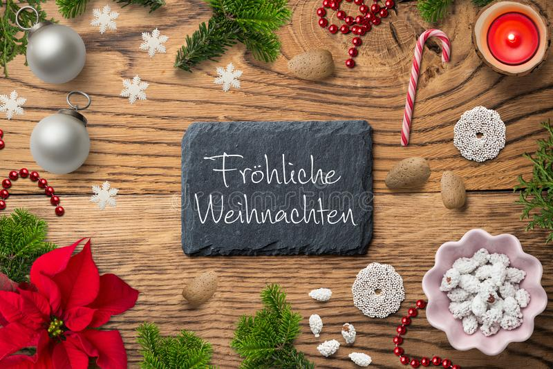 """Decorazione di Natale ed il messaggio tedesco per """"il Buon Natale fotografie stock"""