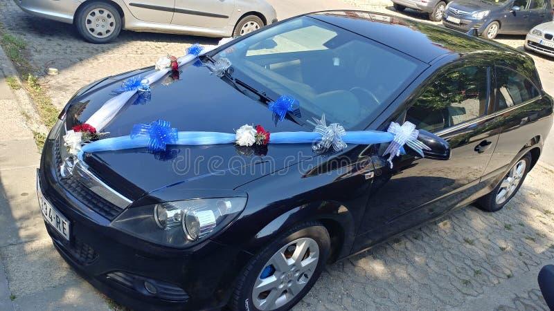 Decorazione di nozze su un'automobile fotografia stock