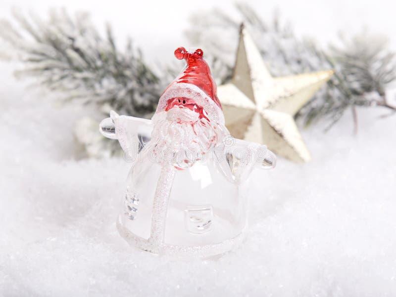 Decorazione dorata di Natale con Santa di vetro fotografia stock libera da diritti
