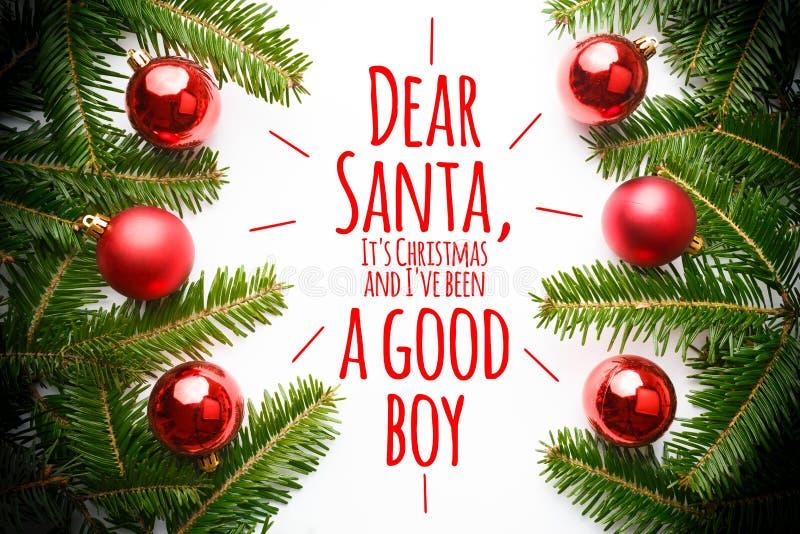 Decorazioni di Natale con il ` Santa cara, del messaggio ` VE di Natale e di I del ` s stato un buon ` del ragazzo fotografia stock libera da diritti