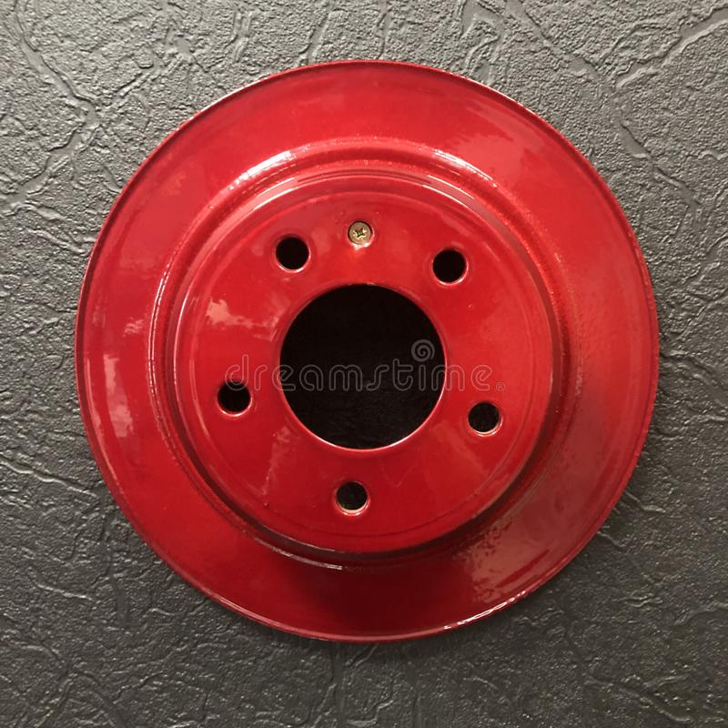 Decore car red brake disc on the wall. Auto, automobile, automotive, disk, transportation, wheel, black, caliper, isolated, metal, new, part, repair, safety royalty free stock images