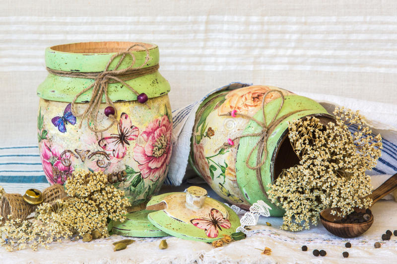 Decoupage decorated wooden containers. Wooden containers hand decorated in decoupage technique in farmhouse style on rustic backgruond stock photography