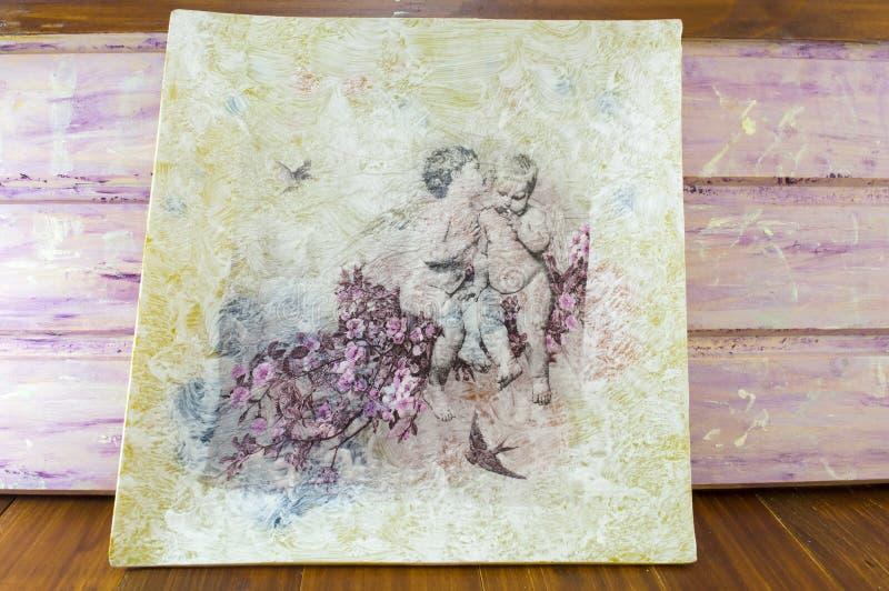Decoupage fez a pintura com símbolos da infância imagens de stock royalty free