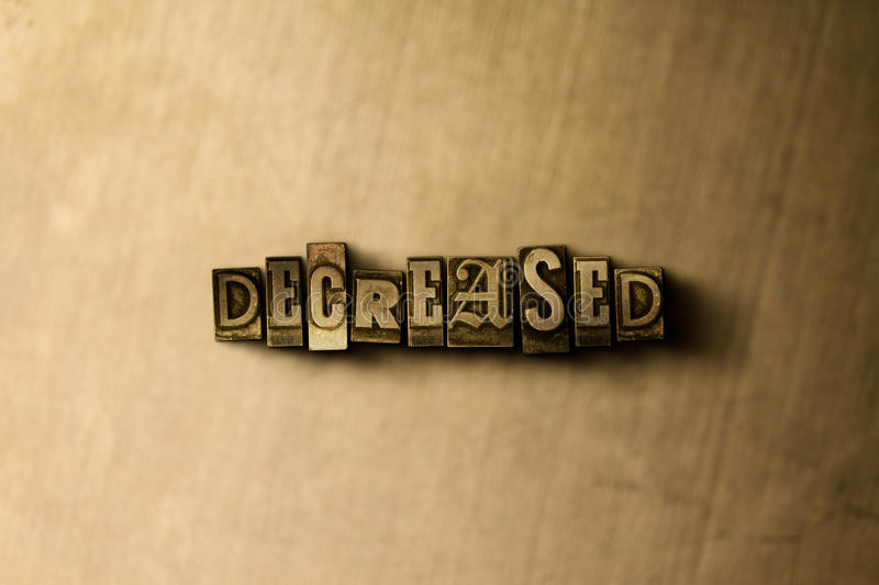 DECREASED - close-up of grungy vintage typeset word on metal backdrop. Royalty free stock illustration. Can be used for online banner ads and direct mail stock image