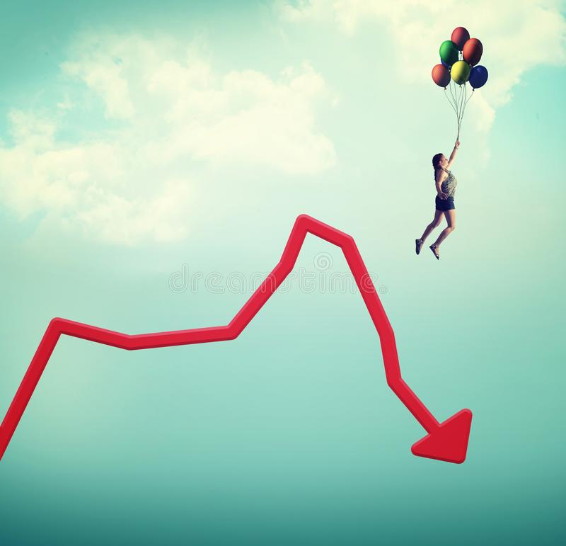 Decreased graph. image of concept. Woman flying with balloons off a decreasing graph stock photo