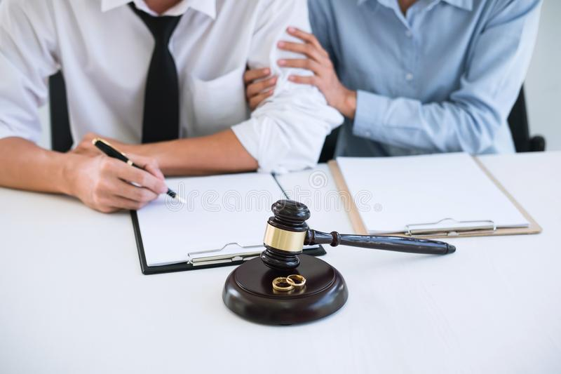 Decree of divorce dissolution or cancellation of marriage, hus. Band and wife during divorce process with lawyer or counselor and signing of divorce contract stock image