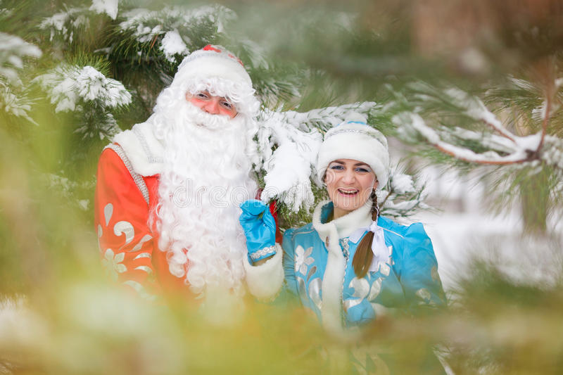 Ded Moroz (Father Frost) and Snegurochka (Snow Maiden) with gifts bag. Russian Christmas characters: Ded Moroz (Father Frost) and Snegurochka (Snow Maiden) with royalty free stock image