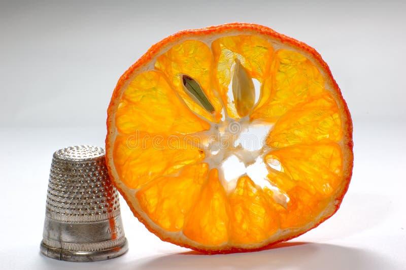 Dedal e laranja imagens de stock