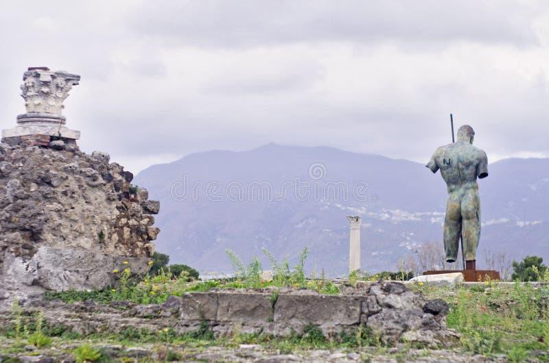Dedalo Bronze Statue in Pompeii ruins, italy. Roman Pompeii ruins, by Igor Mitoraj in Regio VIII royalty free stock images