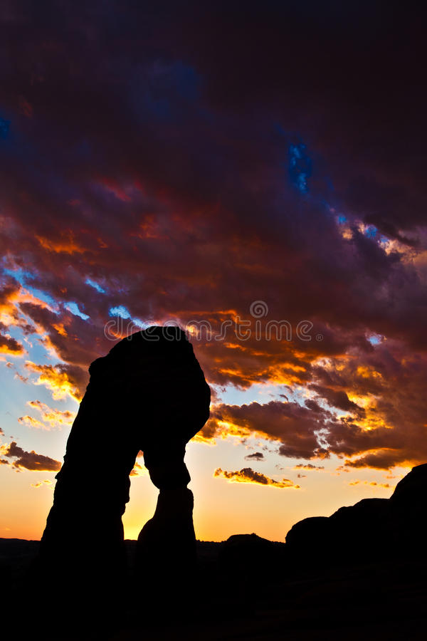 Dedicate Arch Sunset in Arches National Park, Utah. Golden Moment of Dedicate Arch during Sunset in Arches National Park, Utah royalty free stock image