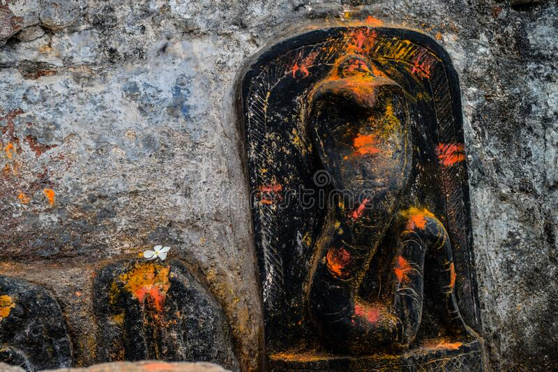 Picture of dedicated temple for snake god carved on black stone. Dedicated temple for snake god carved on black stone stock photo