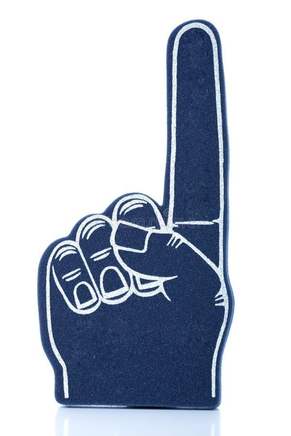 Dedo azul de la espuma con el primer dedo que destaca imagen de archivo