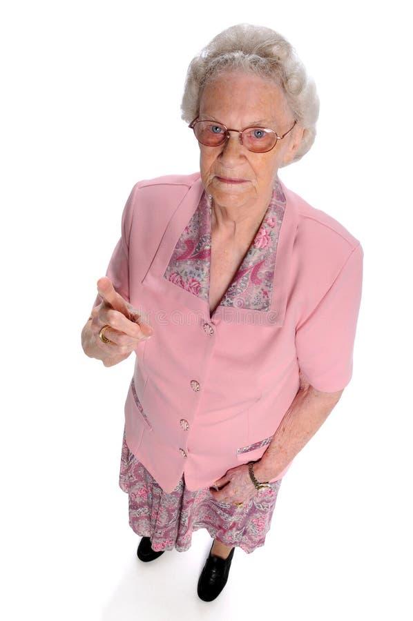 Dedo de Pinting da mulher mais idosa fotografia de stock