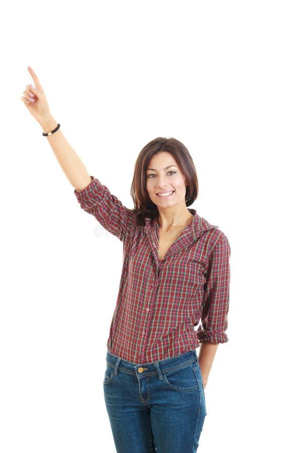 Dedo entusiasmado novo do ponto da mulher que mostra algo levantar o lado fotos de stock