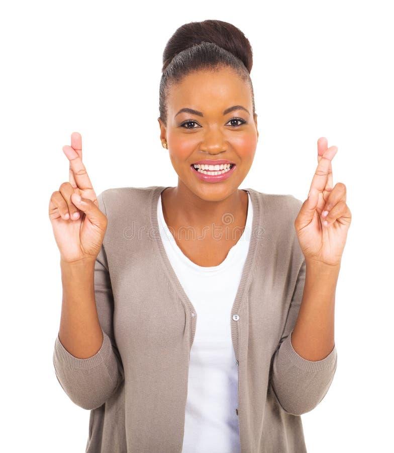 Dedos africanos da mulher cruzados fotos de stock