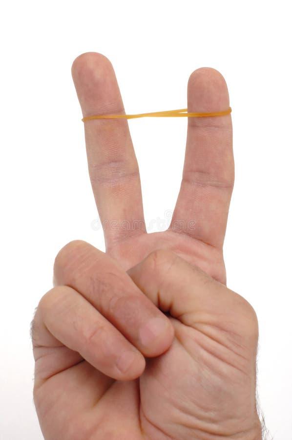 Dedos con caucho fotografía de archivo