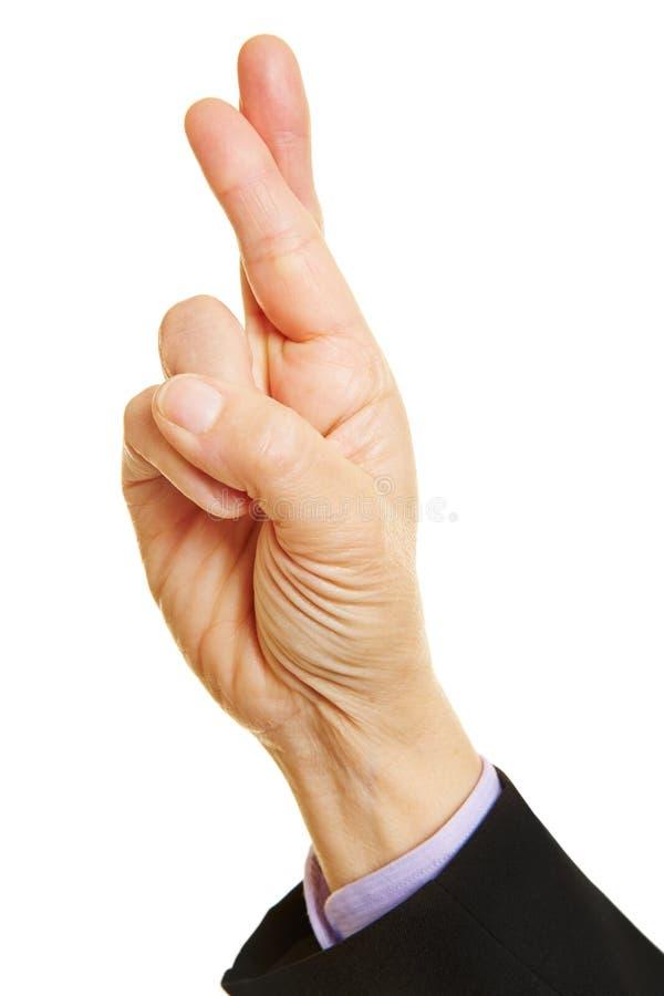 Dedos cruzados que dizem a verdade fotografia de stock