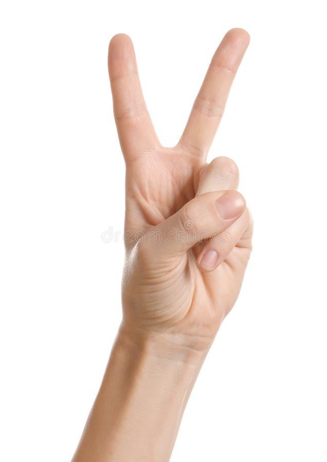 Dedos da exibição dois da mulher no fundo branco foto de stock royalty free