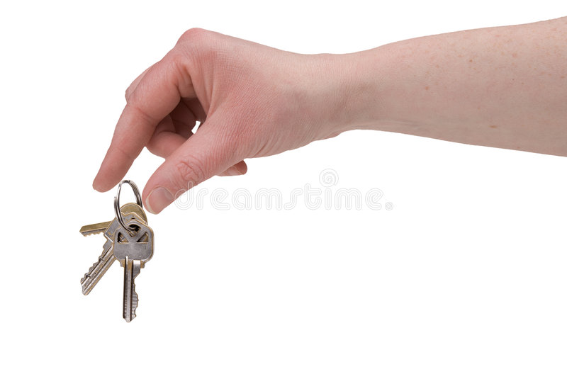 Dedos da mulher com chaves foto de stock