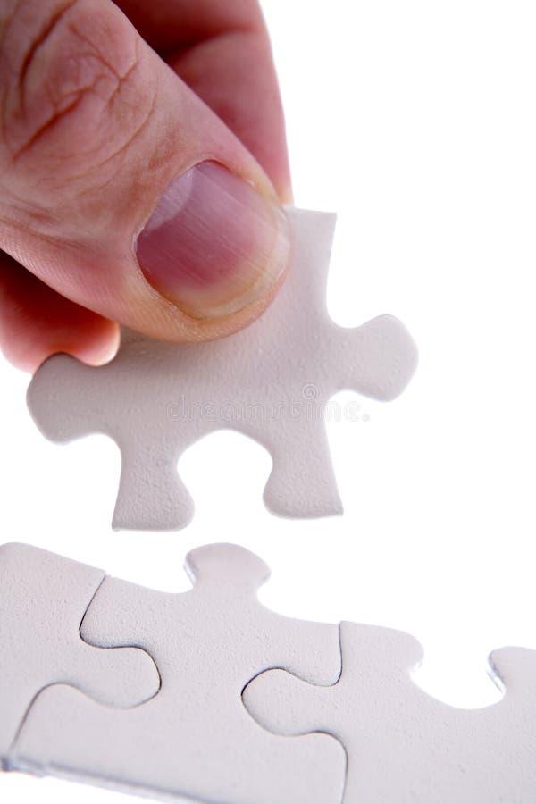 Dedos e partes do enigma imagem de stock royalty free