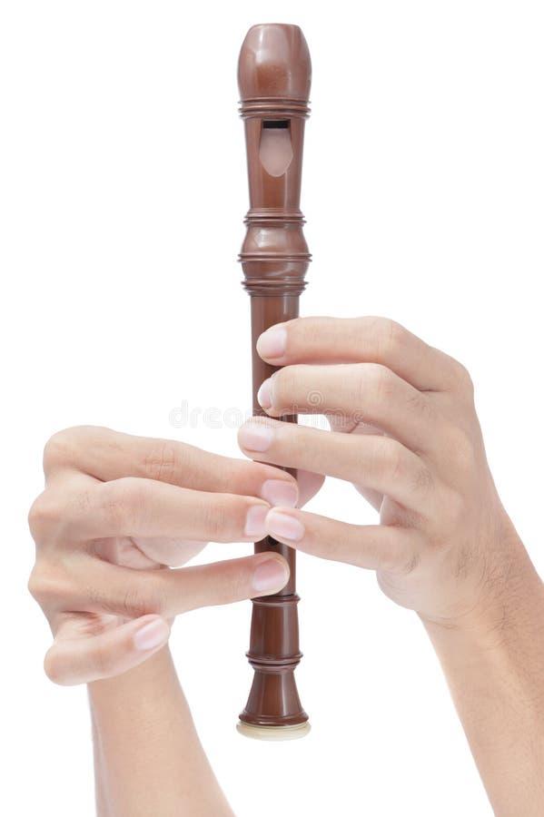Dedos que jogam a flauta do soprano imagem de stock royalty free