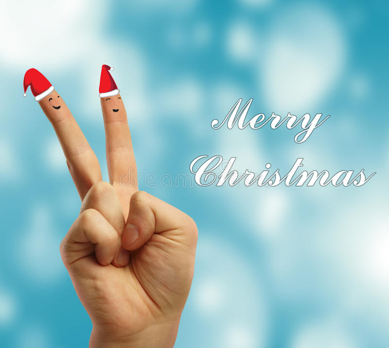 Dedos vestidos nos chapéus vermelho-brancos de Papai Noel. foto de stock