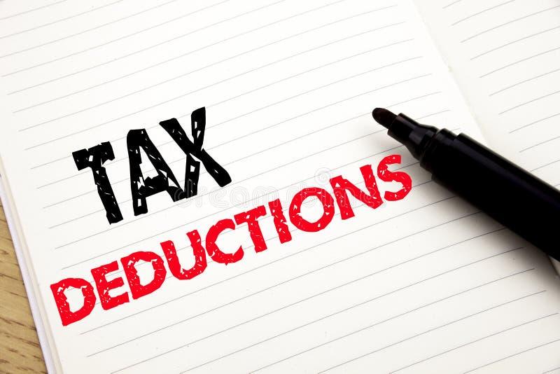 Deduções fiscais Conceito do negócio para a dedução entrante do dinheiro dos contribuintes da finança escrita no caderno com espa foto de stock